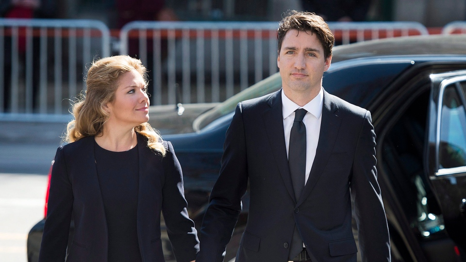 Prime Minister Justin Trudeau and his wife Sophie Gregoire Trudeau arrive for the funeral of Jean Lapierre and Nicole Beaulieu in Montreal, Saturday, April 16, 2016. (THE CANADIAN PRESS / Graham Hughes)