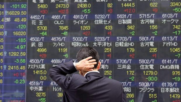 A man looks at an electronic stock board of a securities firm in Tokyo, Monday, April 4, 2016. (AP Photo / Koji Sasahara)