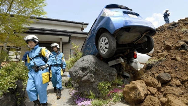 Police officers conduct a search operation at the site of a landslide caused by an earthquake in Minamiaso, Kumamoto prefecture, Japan, Sunday, April 17, 2016.  (Yohei Fukai/Kyodo News via AP)