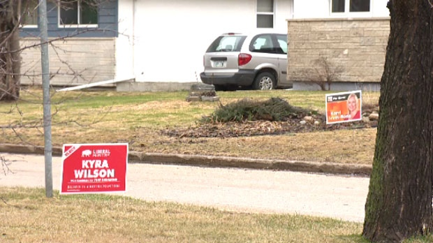 Campaign signs in Fort Richmond for incumbent NDP candidate Kerri Irvin-Ross and Liberal Kyra Wilson.