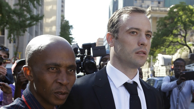 Oscar Pistorius, right, escorted by unidentified man as he leaves the high court in Pretoria, South Africa on Monday, April 18, 2016. (AP / Themba Hadebe)