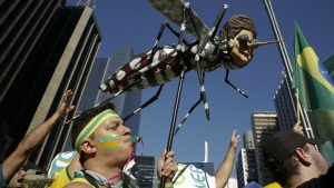 A demonstrator holds an Aedes aegypti mosquito doll depicting Brazil's President Dilma Rousseff during a march demanding her impeachment in Sao Paulo, Brazil on Sunday, April 17, 2016. (AP / Andre Penner)