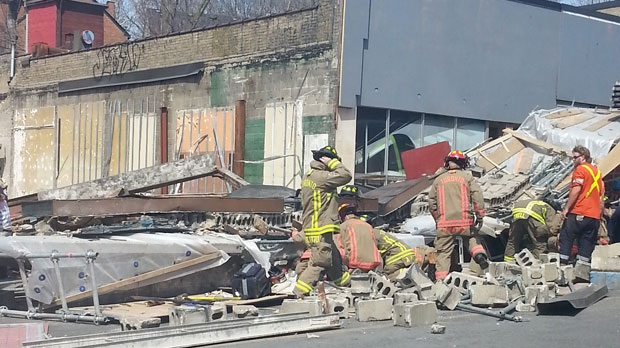 Firefighters are seen surveying debris following a scaffolding collapse in the Eglinton Avenue and Bathurst Street area on Monday, April 18, 2016. (y2jasmine@gmail.com)
