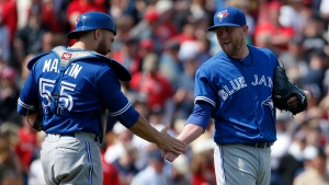 Toronto Blue Jays catcher Russell Martin, left, congratulates pitcher Drew Storen after closing out the game for a 4-3 win against the Boston Red Sox at Fenway Park, Monday, April 18, 2016, in Boston. (Mary Schwalm/The Associated Press)