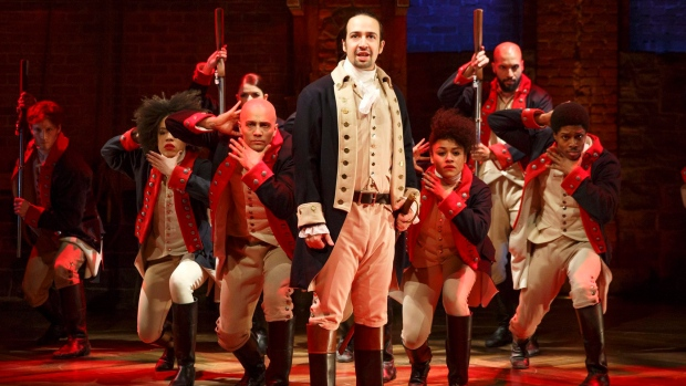 """This image released by The Public Theater shows Lin-Manuel Miranda, foreground, with the cast during a performance of """"Hamilton,"""" in New York. (Joan Marcus / The Public Theater via AP)"""