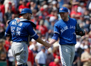 Toronto Blue Jays catcher Russell Martin (55) congratulates pitcher Drew Storen (45) after closing out the game for a 4-3 win against the Boston Red Sox at Fenway Park, Monday, April 18, 2016, in Boston. (AP Photo/Mary Schwalm)