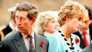 Prince Charles and Diana, the Princess of Wales look their separate ways, during a memorial service on their tour of South Korea on on Wednesday, Dec. 20, 1992. (AP)