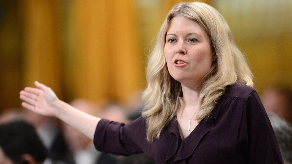 Conservative MP Michelle Rempel responds to a question during question period in the House of Commons on Parliament Hill in Ottawa on Tuesday, June 11, 2013. THE CANADIAN PRESS/Sean Kilpatrick