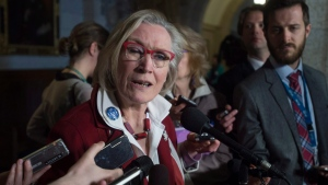 Minister of Indigenous and Northern Affairs Carolyn Bennett speaks with reporters following a party cabinet meeting on Parliament Hill in Ottawa, Tuesday April 19, 2016. THE CANADIAN PRESS/Adrian Wyld