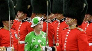Queen Elizabeth II inspects a Guard of Honor after her arrival on Parliament Hill in Ottawa, July 1, 1990, to take part in Canada Day ceremonies. (CP PHOTO/Ron Poling)