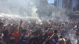 A crowd of people take part in celebrations at Yonge-Dundas Square in downtown Toronto to mark 420, the international pot holiday Wednesday April 20, 2016. (Nneka Elliott /CP24)