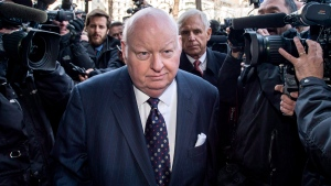 Suspended senator Mike Duffy is followed by his lawyer Donald Bayne (right) as he arrives at the courthouse in Ottawa, Ont. for his first court appearance on April 7, 2015. (Justin Tang / The Canadian Press)
