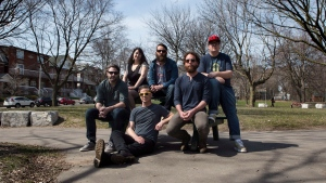 Canadian folk pop band Strumbellas members (left to right) Darryl James, Isabel Ritchie, Jeremy Drury, Simon Ward, Jonathan Hembrey and Dave Ritter pose for a photo in Toronto on Monday, April 18, 2016. THE CANADIAN PRESS/Chris Young