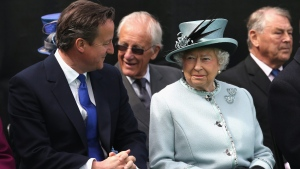 Britain's Prime Minister David Cameron talks with Queen Elizabeth II, at the Magna Carta memorial at Runnymede, England, on Monday, June 15, 2015. (Chris Jackson / Pool photo via AP)
