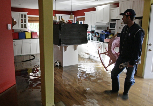 Darren Abelman pauses as he stands in his flooded home in Chilliwack, B.C., on Friday, January 9, 2009. (THE CANADIAN PRESS/Darryl Dyck)
