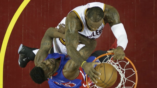 LeBron James dunks against the Pistons