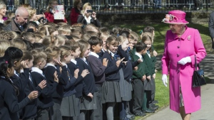 Britain's Queen Elizabeth II is greeted by children as she officially opens the new Bandstand at Alexandra Gardens, a day ahead of her 90th birthday, in Windsor, England on Wednesday, April 20, 2016. (Arthur Edwards / Pool Photo via AP)