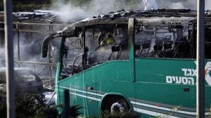 An Israeli firefighter is seen inside a burnt bus in Jerusalem, on April 18, 2016. (Mahmoud Illean / AP)