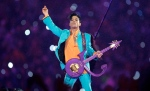 In this Feb. 4, 2007 file photo, Prince performs during the halftime show at the Super Bowl XLI football game at Dolphin Stadium in Miami. The halftime show has become one of the year's top cultural moments, so anticipated that it is commonly seen by more people than the game itself. (AP Photo/Chris O'Meara, File)