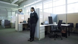 A security guard stands watch at the Canadian Border Services Agency's integrated processing area at Pearson International Airport in Toronto, Ont., on Tuesday, December 8, 2015. (THE CANADIAN PRESS/Darren Calabrese)