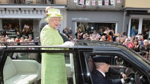 Britain's Queen Elizabeth II and Prince Philip ride in an open-topped Range Rover close to Windsor Castle, as she celebrates her 90th birthday, in Berkshire, England, Thursday, April 21, 2016. (John Stillwell/Pool Photo via AP)