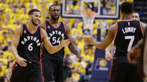 Toronto Raptors guard Kyle Lowry (7) greets guard Cory Joseph (6) and forward Patrick Patterson (54) as they come off the court for a timeout during the first half of Game 3 of an NBA first-round playoff basketball series against the Indiana Pacers in Indianapolis, Thursday, April 21, 2016. (AP Photo / Michael Conroy)