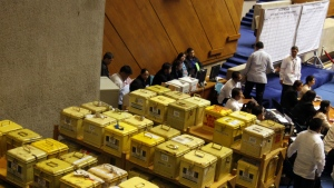 Security personnel and staff members of the Lower House keep a close eye on ballot boxes containing certificates of canvass, during the second day of deliberations of the National Board of Canvassers at the House of Representatives in Quezon City north of Manila, Philippines on Wednesday, May 26, 2010. (AP / Pat Roque)