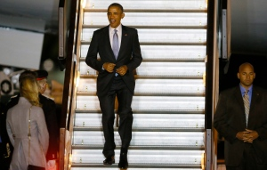 President of the United States Barack Obama smiles as he walks down the steps of Air Force One on his arrival at Stansted Airport, England, Thursday, April 21, 2016. (AP Photo/Kirsty Wigglesworth)