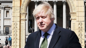 The Mayor of London, Boris Johnson, poses for the media after unveiling an imposing scale replica of Palmyra's Triumphal Arch in Trafalgar Square, in London, Tuesday, April 19, 2016. (AP / Frank Augstein)