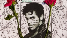 Fans gather at memorials for Prince