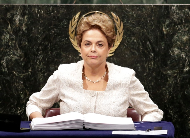 Dilma Rousseff, President of Brazil, signs the Paris Agreement on climate change, Friday, April 22, 2016 at U.N. headquarters. (AP / Mark Lennihan)