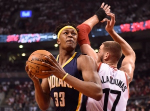Indiana Pacers' Myles Turner (33) moves around Toronto Raptors' Jonas Valanciunas (17) as he drives to the net during first half round one NBA basketball playoff action in Toronto on April 16, 2016. (Frank Gunn / The Canadian Press)