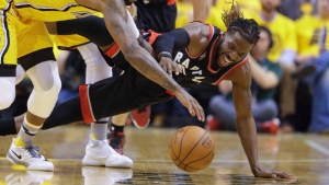 Toronto Raptors forward DeMarre Carroll, right, and Indiana Pacers forward Paul George (13) go for a loose ball during the first half of Game 3 of an NBA first-round playoff basketball series in Indianapolis, Thursday, April 21, 2016. (THE CANADIAN PRESS / AP / Michael Conroy)
