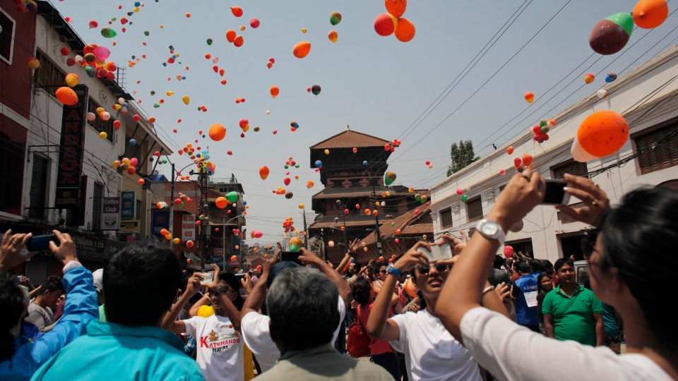 Nepalese people release balloons in memory of those who died in last year's devastating earthquake in Kathmandu, Nepal, Saturday, April 23, 2016. The April 25, 2015, earthquake, killed nearly 9,000 people. (AP / Niranjan Shrestha)
