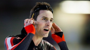 Denny Morrison looks at his time after competing in a speedskating race in Calgary, Alta., Thursday, March 17, 2016. (THE CANADIAN PRESS / Jeff McIntosh)