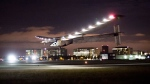 Solar Impulse 2 lands at Moffett Field in Mountain View, Calif., after crossing the Pacific Ocean on Saturday, April 23, 2016. (AP / Noah Berger)