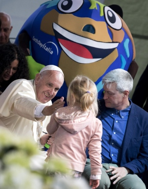 Pope Francis reaches out to caress a young girl during his appearance at an Earth Day event in Rome, Sunday, April 24, 2016. (Claudio Peri / ANSA)