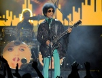 In this May 19, 2013, file photo, Prince performs at the Billboard Music Awards at the MGM Grand Garden Arena in Las Vegas. Tickets for what turned out to be Prince's last concert, in Atlanta, went on sale just eight days before he was scheduled to play and sold out almost instantly. (Photo by Chris Pizzello / Invision / AP)