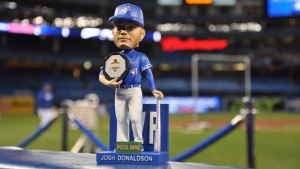 Toronto Blue Jays fans waited patiently to get their hands on one of 20,000 Josh Donaldson MVP bobbleheads, seen here, at the MVP's appreciation game on Sunday, April 24, 2016 in Toronto. (Twitter: Toronto Blue Jays)