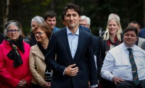 Prime Minister Justin Trudeau speaks to the media with his cabinet at a Liberal Party cabinet retreat in Kananaskis, Alta., Sunday, April 24, 2016. (THE CANADIAN PRESS / Jeff McIntosh)