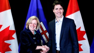Prime Minister Justin Trudeau, right, meets with Alberta Premier Rachel Notley following meetings at a Liberal Party cabinet retreat in Kananaskis, Alta., Sunday, April 24, 2016. (Jeff McIntosh / THE CANADIAN PRESS)