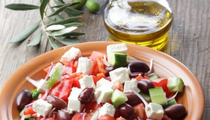 Mainstays of the Mediterranean diet include a high intake of vegetables, legumes, fruits, nuts and unrefined cereals, as well as plenty of olive oil, moderate intake of fish, and low-to-moderate intake of dairy, low red meat and poultry, and moderate wine consumption, according to a 2003 study published in the New England Journal of Medicine.
