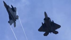 U.S. Air Force F-22 Raptors fly above Andersen Air Force Base, Guam on July 20, 2008. (U.S. Air Force, Airman 1st Class Courtney Witt / AP)