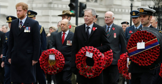 Prince Harry, left, and Lockwood Smith the New Zealand High Commissioner, center, take part in the ANZAC Day commemorations at the Cenotaph in London, Monday April 25, 2016. (AP Photo/Alastair Grant)