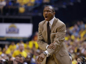 Toronto Raptors coach Dwane Casey question a call during the first half of Game 3 of an NBA first-round playoff basketball series against the Indiana Pacers in Indianapolis on April 21, 2016. (Michael Conroy / AP Photo)