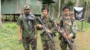 Abu Sayyaf militants on Mindanao island in southern Philippines, on June 11, 2014. (Philippine National Police / AP)