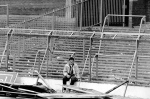 In this April 15, 1989 file photo a lone soccer supporter sits by the damaged fencing at Hillsborough Stadium, in Sheffield, England. (AP Photo, File)