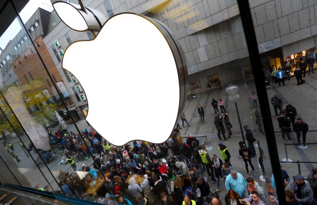 In this Friday, Sept. 25, 2015, file photo, people wait in front of the Apple store in Munich, before the worldwide launch of the iPhone 6s. (AP Photo/Matthias Schrader, File)