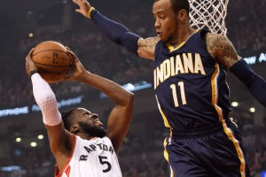 Indiana Pacers' Monta Ellis defends as Toronto Raptors' DeMarre Carroll drives for the basket during first half NBA playoff basketball action in Toronto on April 26, 2016. (Frank Gunn / THE CANADIAN PRESS)