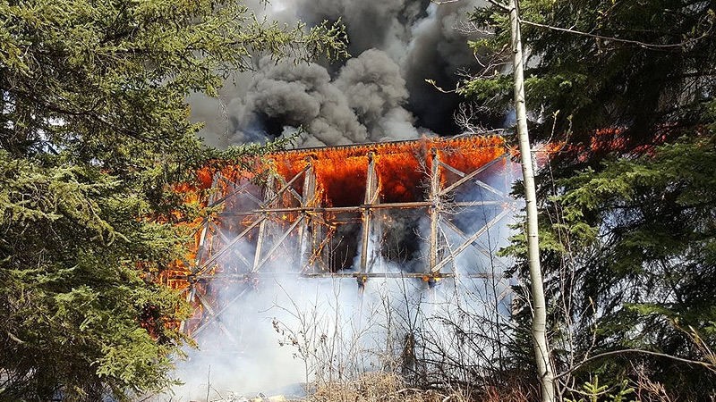 Flames engulf the trestle bridge northwest of Mayerthorpe in an image released by town officials. Supplied.